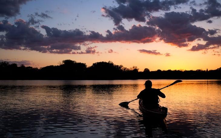 Man kayaking on Lake of the Isles, Minnesota