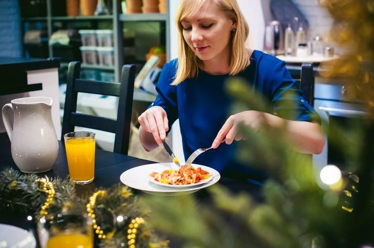 Woman eats breakfast