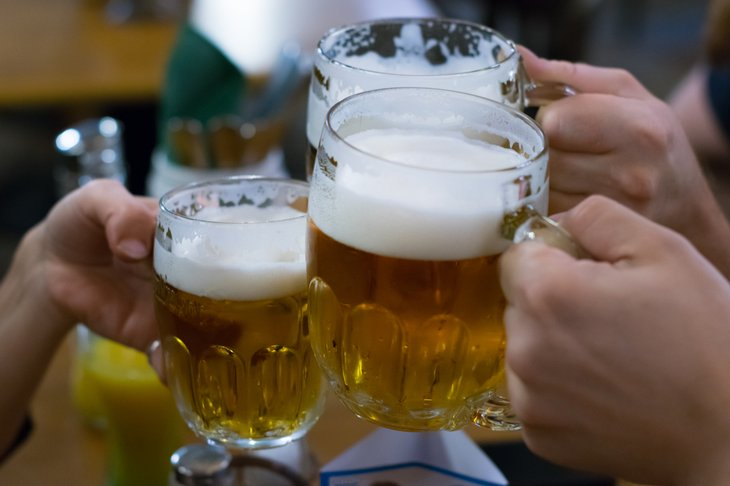 Making a toast with beer glasses
