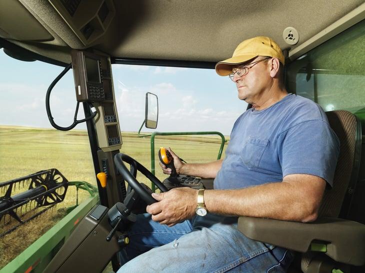 Farmer in harvester