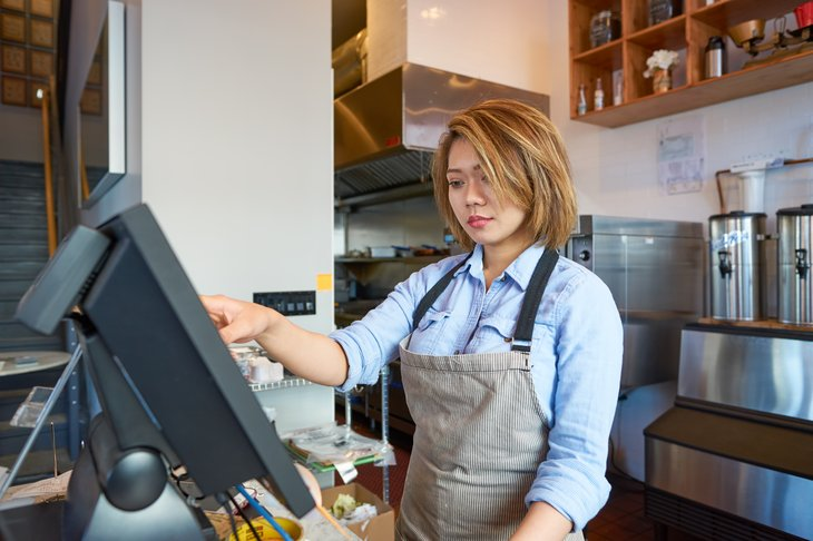 cafe worker at a register