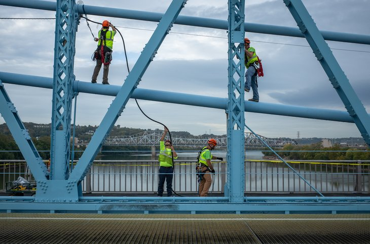 Cable workers on a bridge in Ohio