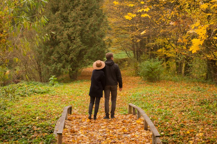 Vermont couple walking in park in Autumn