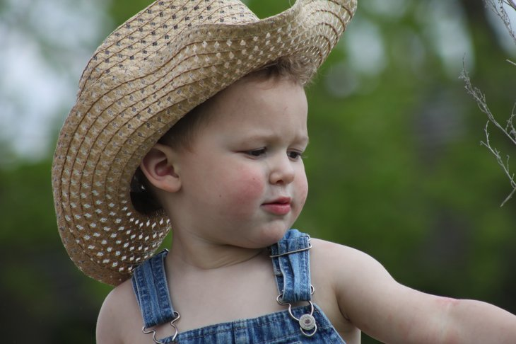 Little boy with cowboy hat on North Dakota Farm