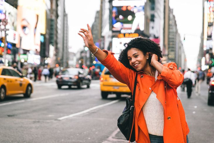 Woman flagging a taxi in New York.