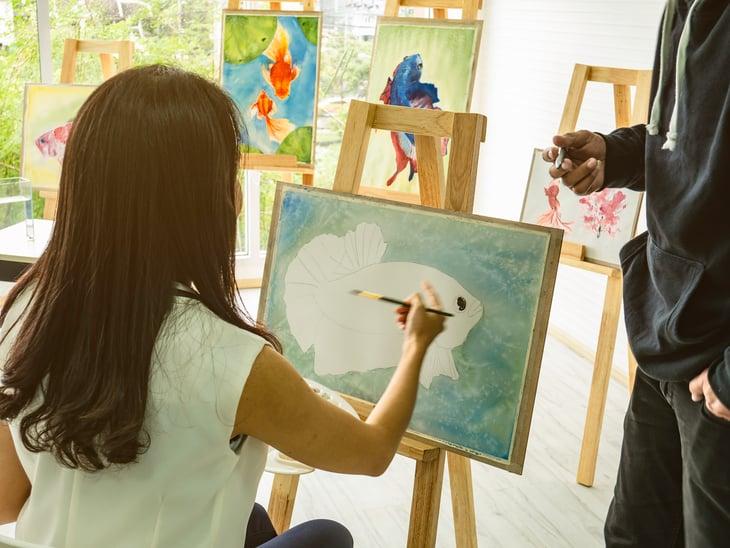 Teacher and student in an art class