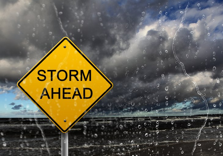 Storm Ahead sign against stormy sky