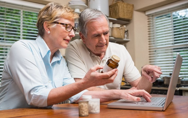 Couple looking at prescription drug bottles