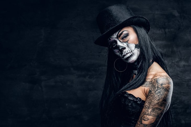 Woman in black with face paint
