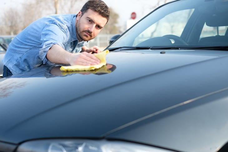 Man waxing car
