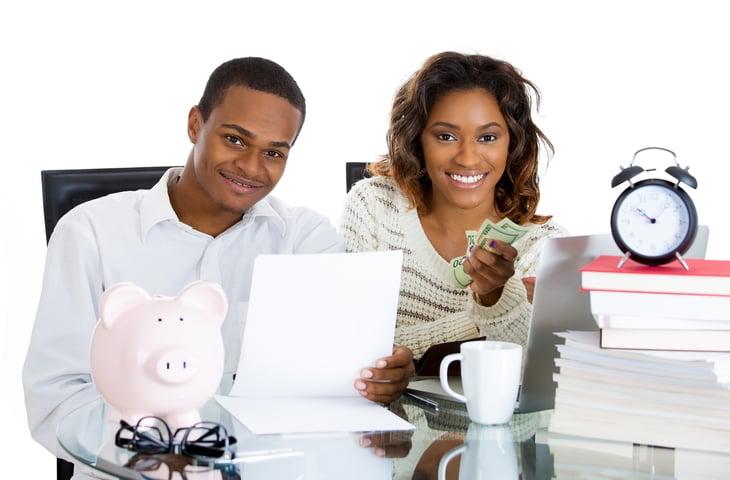 Couple doing bills, paying debt