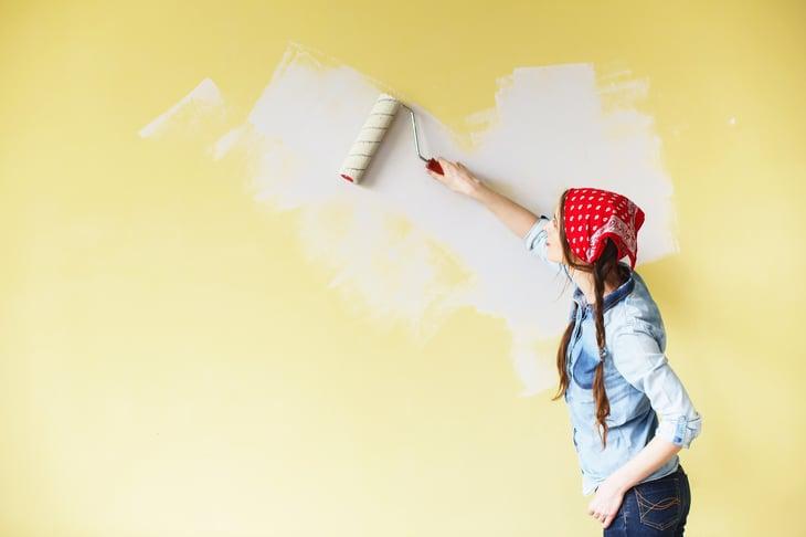 Woman paints room
