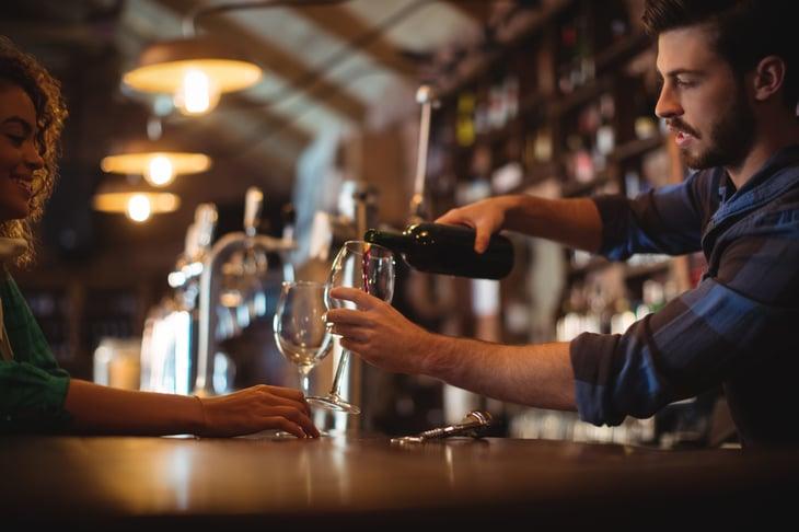 Bartender serving drinks