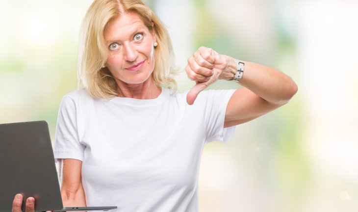 Middle age blonde woman using computer