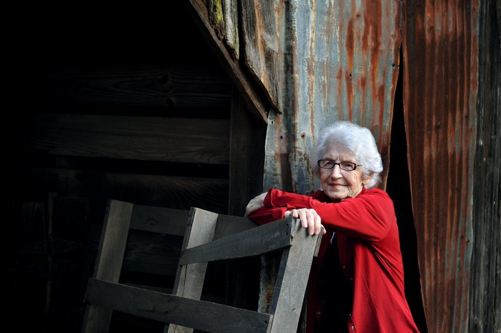Woman by old Arkansas barn
