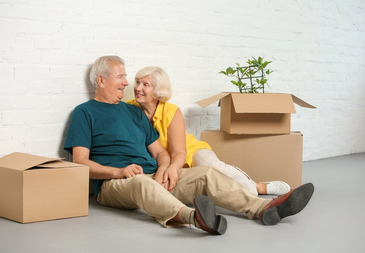 Older couple packing boxes