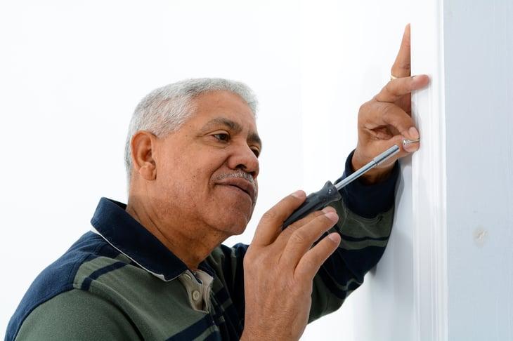 senior man elder home repair african american hispanic