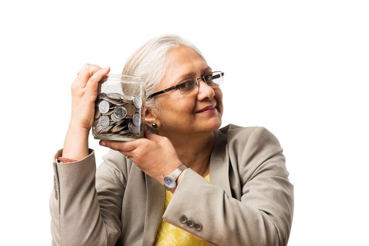 senior elder Indian asian business woman money saving