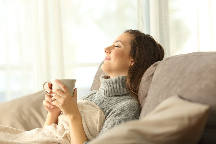 Woman relaxing holding a coffee