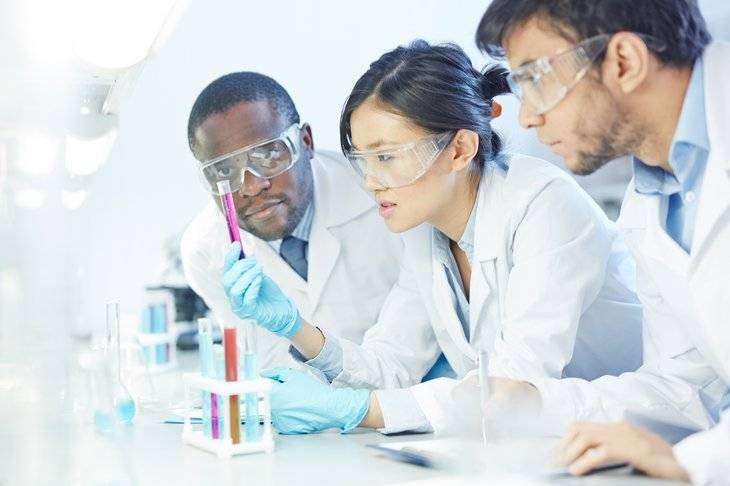 multi ethnic Group of scientists studying chemical reaction multiethnic
