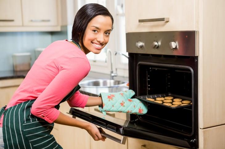 Woman near oven