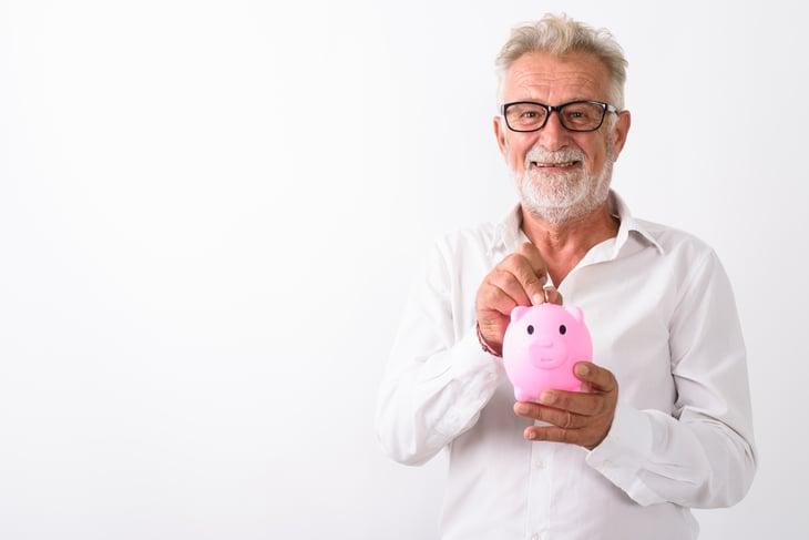Senior man with piggybank