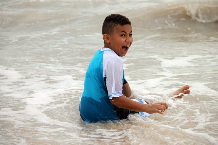 Young Boy playing Ocean