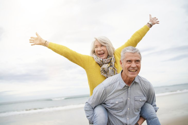 A retired couple celebrates their freedom at the beach