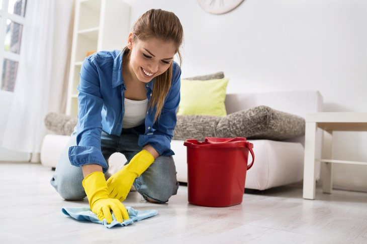 Woman cleaning floors