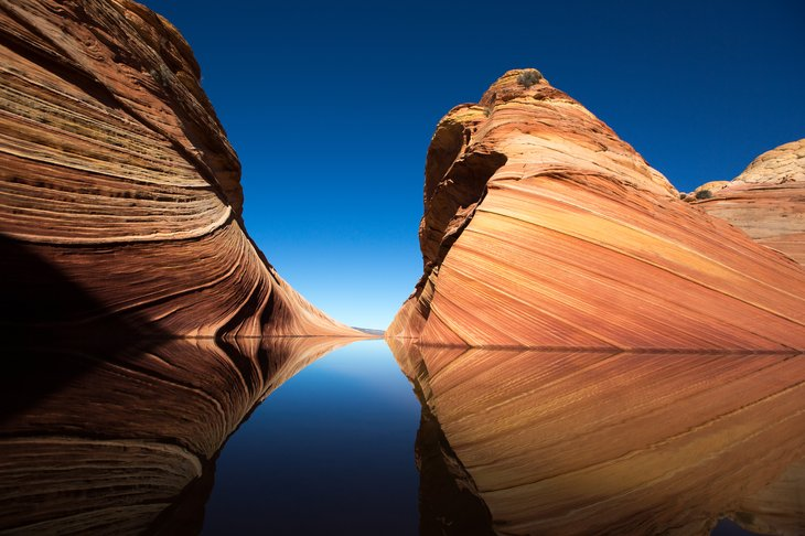 Cliffs reflecting in the water surface in the Wave, Arizona.