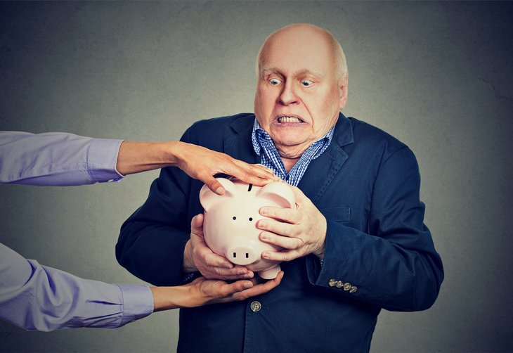 Senior protecting his piggy bank from a thief