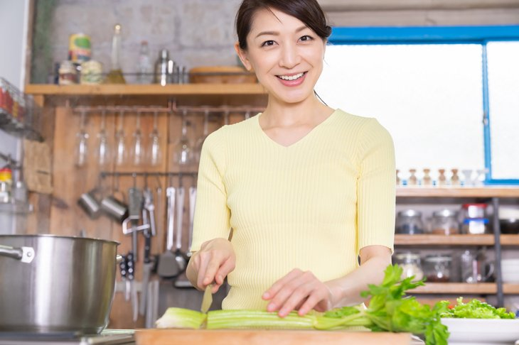 Woman chopping celery for salad