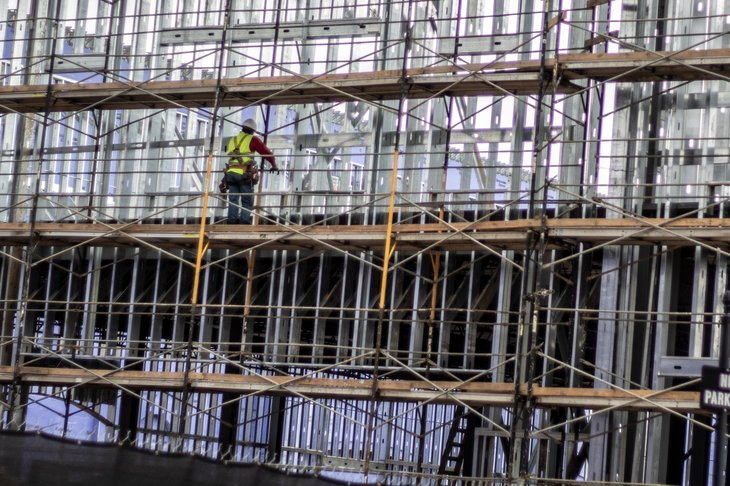 Construction worker works overtime on a new mall site in Madison, Mississippi