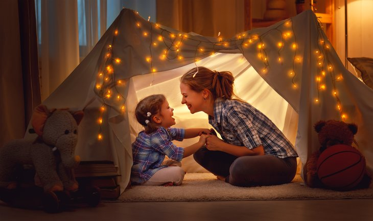 lights mother and daughter playing home tent
