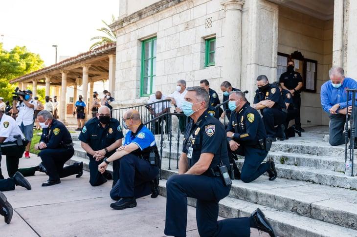 Police kneel with protestors in Coral Gables, Florida