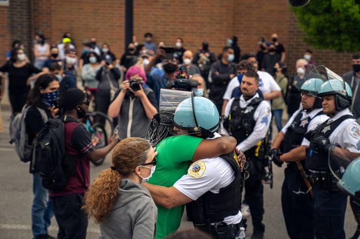 Chicago police officer hugs protestor