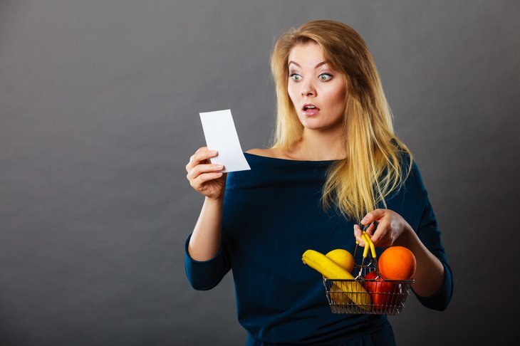 Shopper surprised by high prices on a grocery receipt
