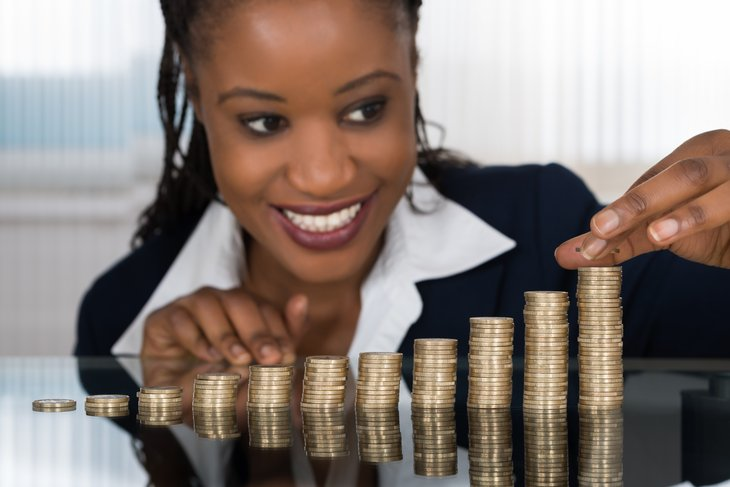 Woman piling up coins