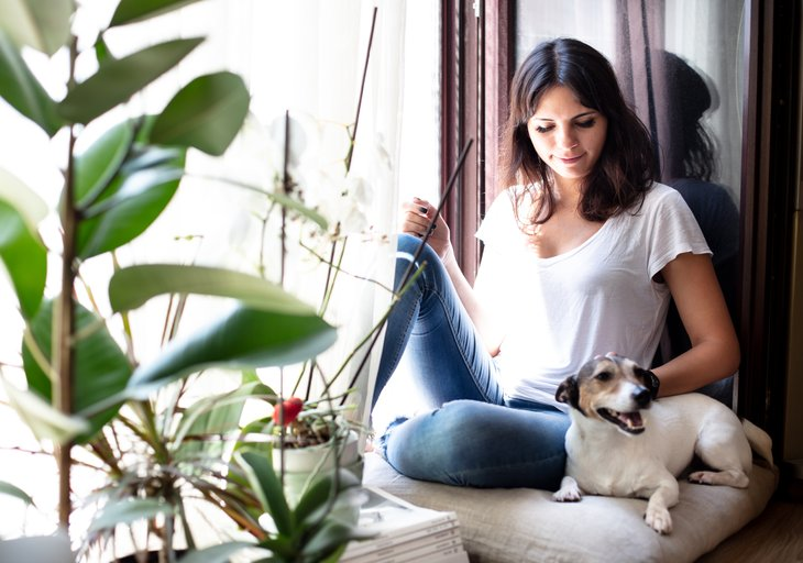 Woman with dog in house
