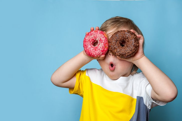 Little boy child fun doughnut donut
