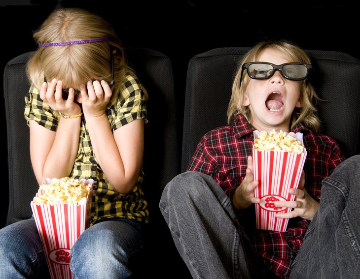 children kids movies Frightened Boy and Girl Wearing New Style 3-D Glasses Movie Theater