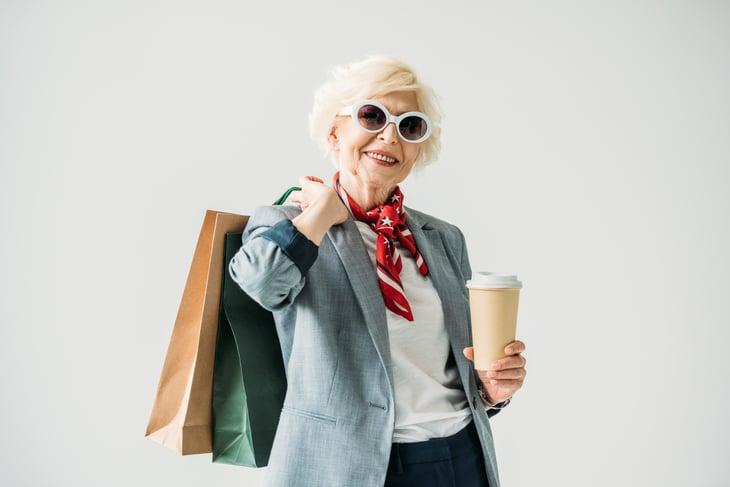 A happy older shopper takes advantage of senior discounts