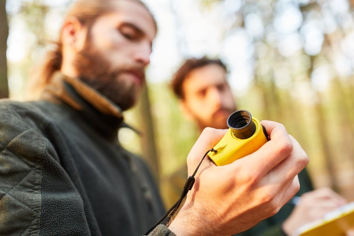 By Robert Kneschke Royalty-free stock photo ID: 1418174957 Two men foresters rangefinder to measure the height of the tree