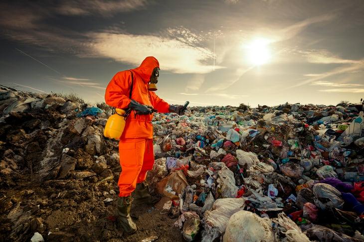 Environmental engineer measuring air pollution municipal landfill