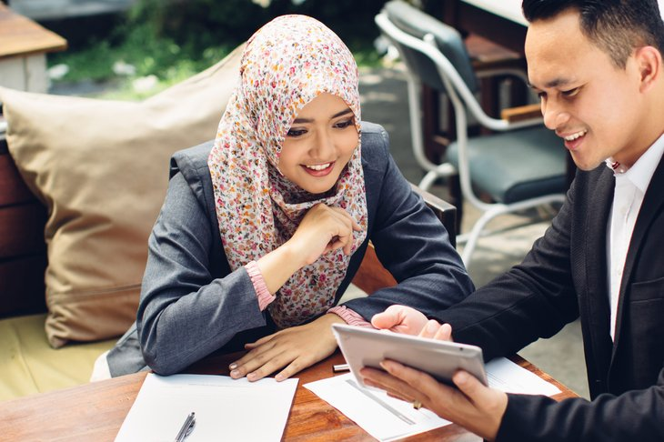 Woman with financial adviser
