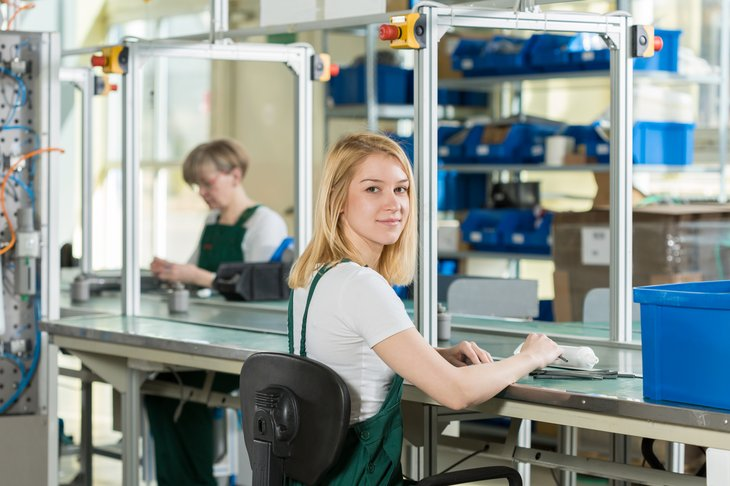 young woman worker production line