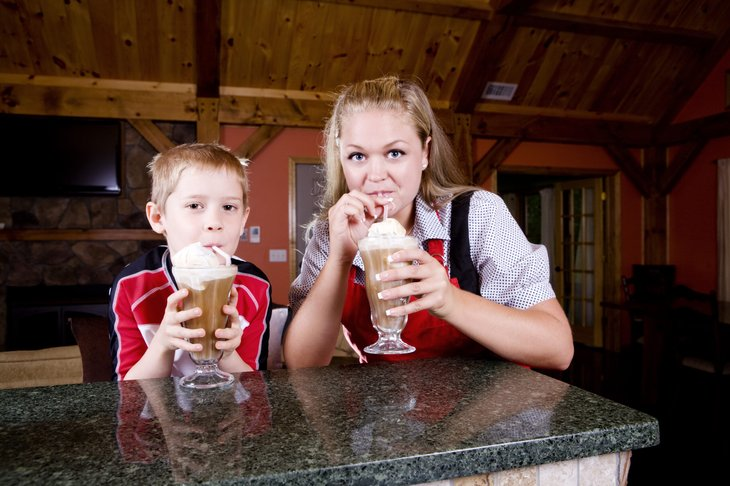 Mother and child enjoy root beer floats.