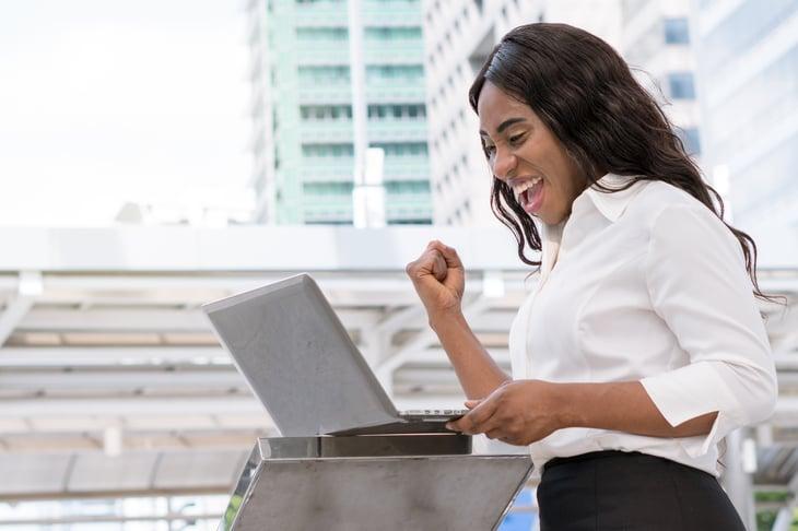Happy female employee celebrating employed new job