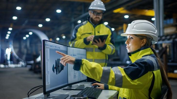 Industry Female Industrial Engineer woman man factory hard hat Designs Engineer Talks Tablet Computer