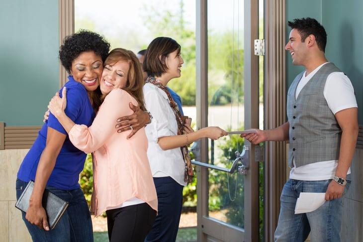 hug people greeting each other